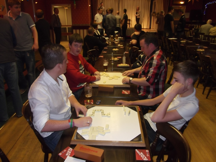 Dominoes are underway but Reece Scott (front right) doesn't look too enthusiastic.