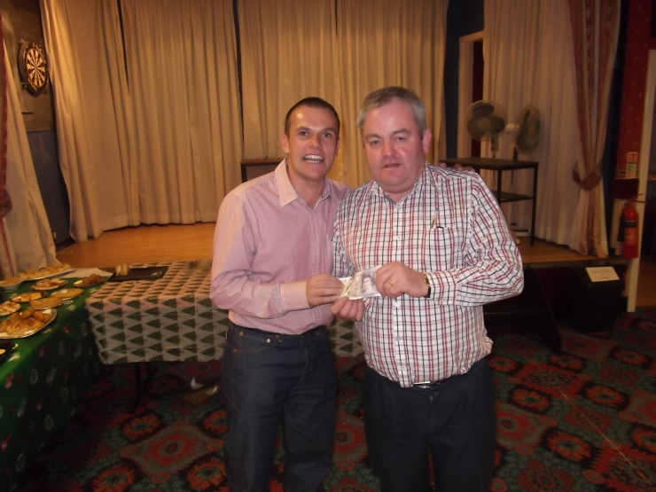 Chairman Geoff Eltringham (L) presenting 'honest' Colin Burnikell with his prize as team quiz winner.