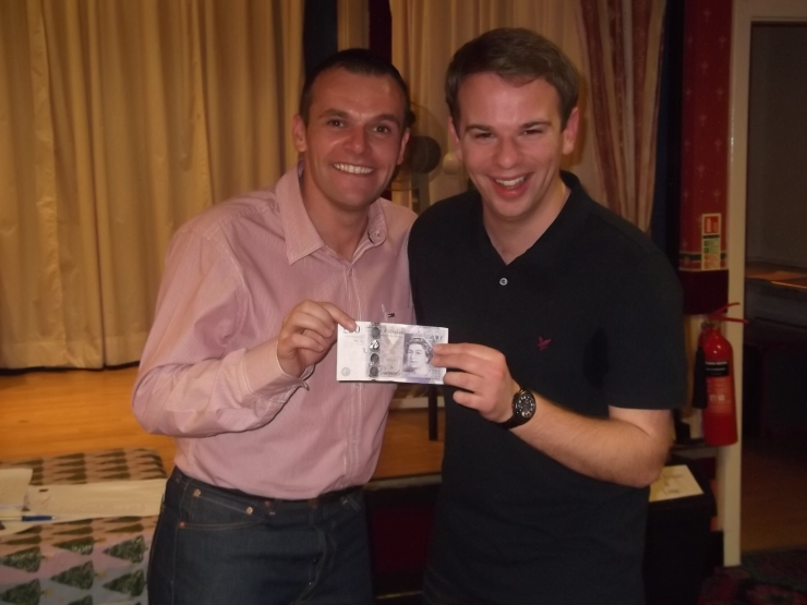 Chairman Geoff Eltringham and darts winner James Simpson (tugging at the £20 note).