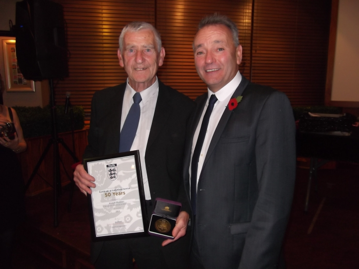Dick being presented with his 50 Year Service Award by John Topping (DFA Secretary).