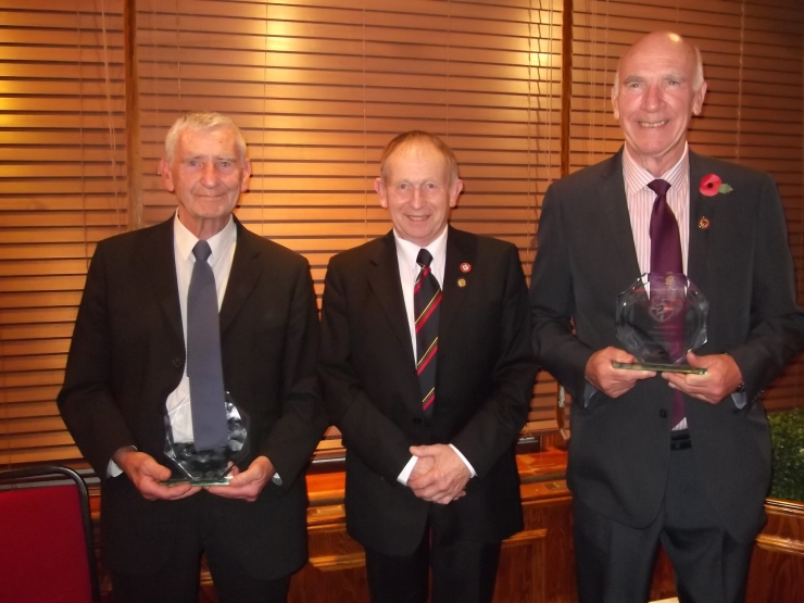 Dick with Peter Willis receiving their 50 Year Service Awards from John Wilson, National RA Representative (centre).